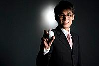 Businessman holding baseball, portrait