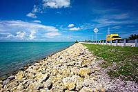 Florida Keys coastline. Van driving along a highway down the coastline in the Florida Keys, USA.