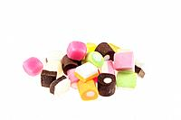 Brightly coloured sweets. Food colourings are added to sweets to make them attractive to children. Such additives may be natural or artificial. Some a...