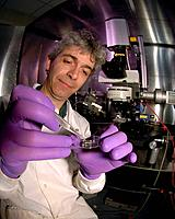 Brain research. Researcher preparing a brain sample for multi_photon microscopy. The brain samples are being studied as part of research into stroke, ...