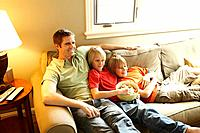 Father watching TV with two sons 12_13
