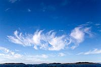 Greenland, Itilleq, Cirrus clouds above mouth of Itilleq Fjord on summer evening