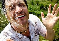 Man splashed with water