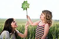 Woman and child holding toy windmill (thumbnail)