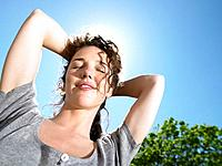 Woman enjoying the sun (thumbnail)