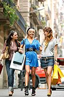 Young women walking with shopping bags