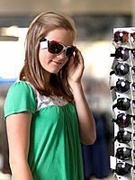 Girl trying sun glasses (thumbnail)