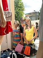 Mother and two girls window shopping