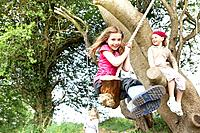 Young girl on rope swing
