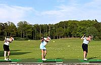 Three ladies at driving range