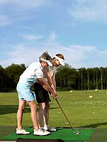 Two women at driving range