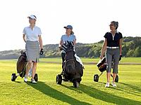 Three women on fairway