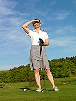 Woman at golf tee (thumbnail)