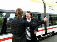 Young couple on train station