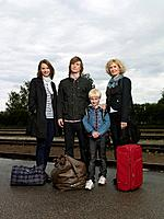 Family on train station