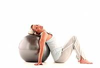 Mature woman lying on exercise ball