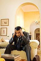 Stressed Businessman Sitting on a Sofa