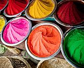 a close up picture of colored dyes in market in india