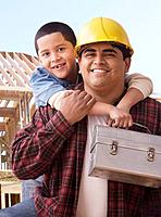 Hispanic construction worker and son holding lunch box