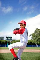 Mixed race boy pitching in baseball game (thumbnail)