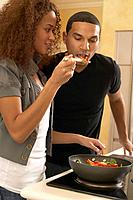 Multi_ethnic couple cooking in kitchen