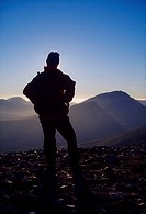 Mount Errigal, County Donegal, Ireland, Hiker on Aghla looking at mountain peak