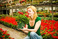 Woman smelling flowering plant
