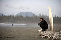 Surfer on beach, Cox Bay near Tofino, British Columbia, Canada