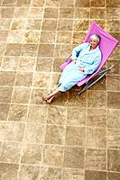 Senior woman relaxing in outdoor chair