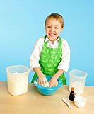 Little girl mixing ingredients