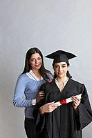 Mother with daughter in a graduation gown