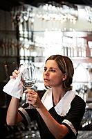 Maid polishing wine glass