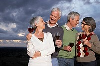 Senior couples drinking red wine