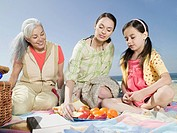 Grandmother, mother, and daughter having picnic
