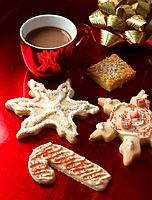 Decorated christmas cookies and cup of chocolate
