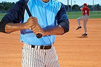 Baseball player preparing to bat, mid section