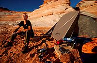 Woman camping at Lake Powell, Arizona, Utah, USA, MR