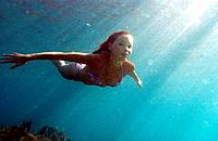 Woman swimming underwater, freediving, Koh Tao, Thailand, MR