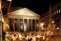 Restaurant tables at Piazza della Minerva, Pantheon, in the evening, Rome, Italy
