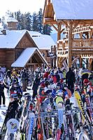 Skiers and snowboarders waiting at the base station at Lake Louise ski resort, Lake Louise, Alberta, Canada