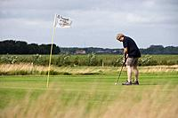 Man on Putting Green, Outrup Golfbane Golf Course, near Varde, Central Jutland, Denmark