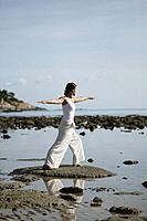 Woman doing Yoga exercises on the beach, Wellness, Relaxation, Health, Thailand