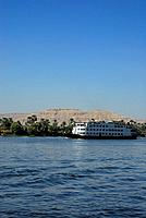 cruise ship on the Nile and palm trees on the western bank, Luxor, Egypt, Africa