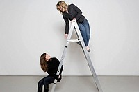 Two women on step ladder (thumbnail)