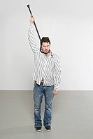 Man hanging himself with a walking stick