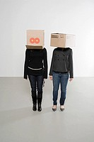 Women with boxes on their heads