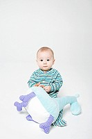 Portrait of a baby boy holding a soft toy (thumbnail)