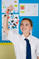 Girl holding molecule model