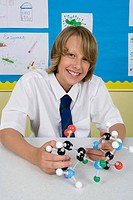 Boy with molecule model