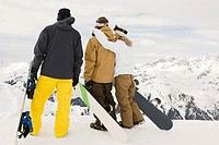 Rear view of snowboarders